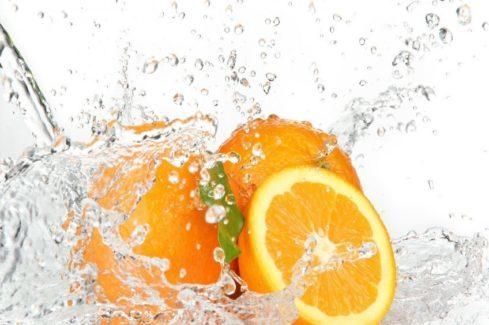 Water sprayed on oranges